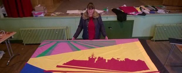 Aileen designing Newland Day main banner.